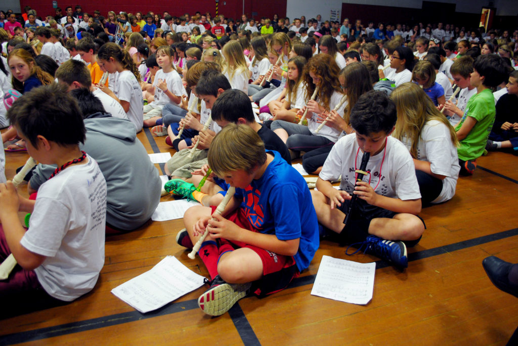 Students at School in Scarborough perform songs on their recorders for the school's final assembly June 13.